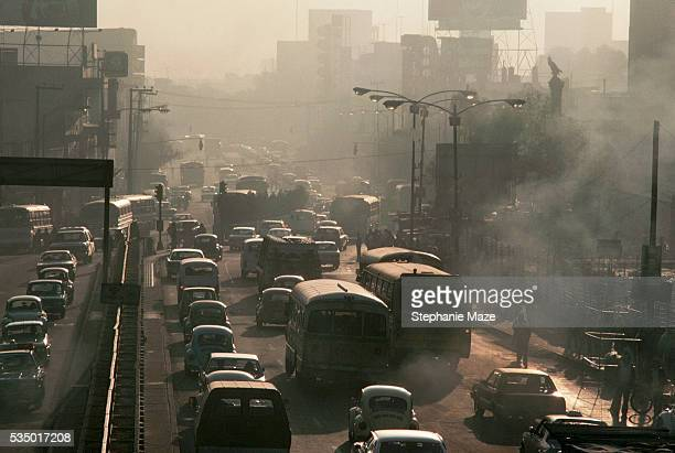 A major street in the Miguel Hidalgo area of Mexico City is clogged with traffic and smog during the morning rush hour | Location Delegacion Miguel...