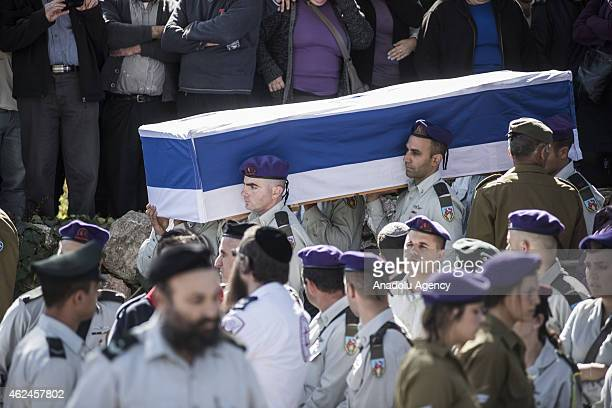Major Yochai Kalengel an Israeli soldier killed in Hezbollah's attack on an IDF convoy near Shebaa farms Wednesday is laid to rest during his funeral...