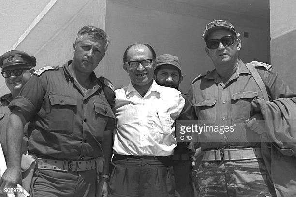 MajorGeneral Ariel Sharon left poses with Menahem Begin center and MajorGeneral Avraham Yoffe June 14 1967 at Jebel Livne in the Sinai Desert days...
