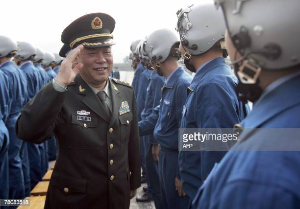 MajorGeneral Liu Liangkai of the Chinese People's Liberation Army Hong Kong Garrison greets outgoing Air Force officers before they leave Hong Kong...