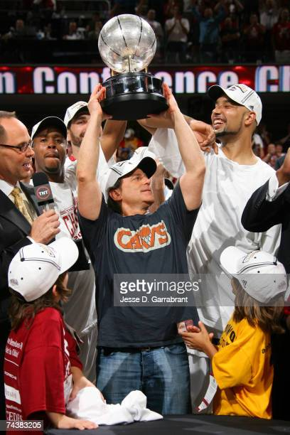 Majority owner Daniel Gilbert of the Cleveland Cavaliers holds the Eastern Conference Championship trophy above his head following Game Six of the...