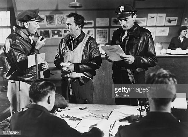 Majors Harvey Stovall and Joe Cobb discuss something while Brigadier General Frank Savage reads a report in the war drama Twelve O'Clock High