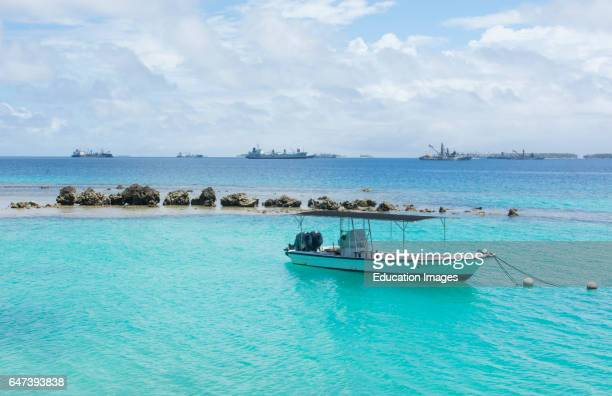 Majuro Marshall Islands boat on blue water in port on rocks