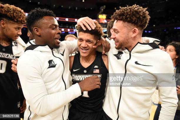 Makai AshtonLangford of the Providence Friars celebrates a win with Maliek White and Drew Edwards during the semifinals of the 2018 Big East Mens...