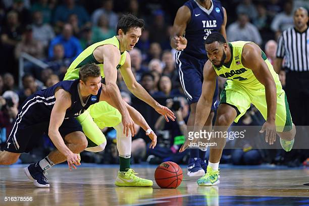 Makai Mason of the Yale Bulldogs battles for the loose ball with Jake Lindsey of the Baylor Bears and Rico Gathers during the first round of the 2016...