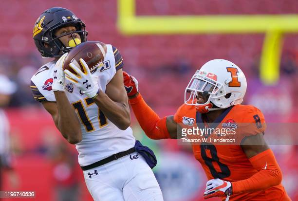 Makai Polk of the California Golden Bears catches a 26 yard pass over Nate Hobbs of the Illinois Fighting Illini during the first half of the RedBox...