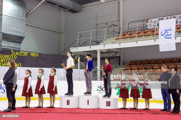 Makar Ignatov of Russia Mitsuki Sumoto of Japan and Tomoki Hiwatashi of the United States pose in the Junior Men medal ceremony during day 3 of the...