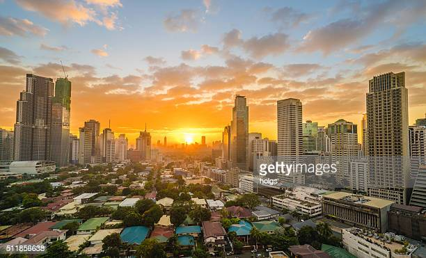 makati city during sunset - makati stock photos and pictures