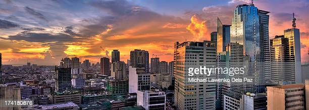 makati city sunset - makati stock photos and pictures