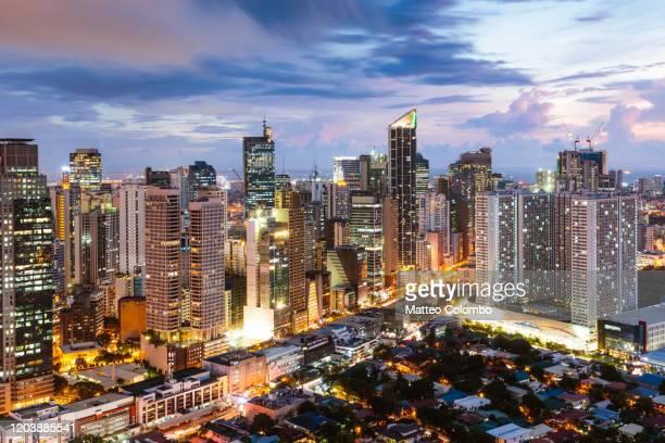 makati skyline at dusk, manila, philippines - マニラ ストックフォトと画像
