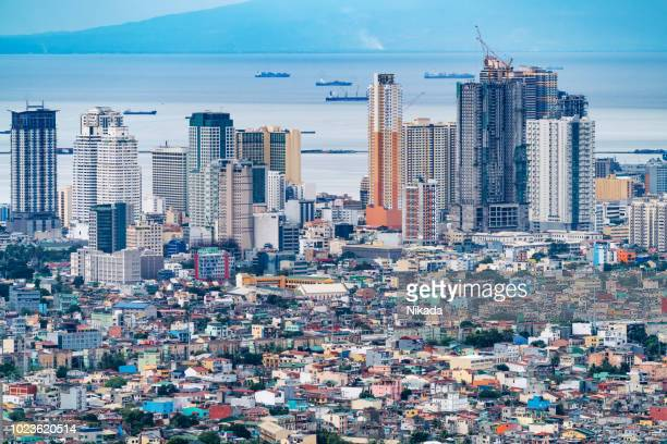 makati skyline, metro manila - philippines - metro manila stock photos and pictures