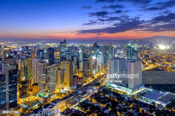makati sunset - makati stock photos and pictures