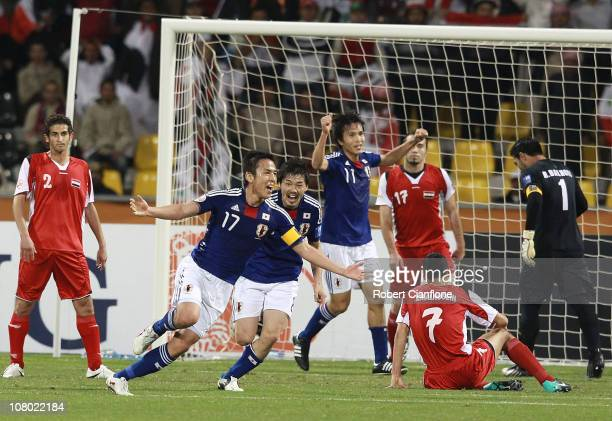 Makato Hasebe of Japan celebrates scoring his goal during the AFC Asian Cup Group B match between Syria and Japan at Qatar Sports Club Stadium on...