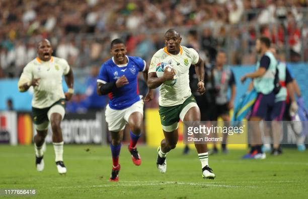 Makazole Mapimpi of South Africa breaks away to score during the Rugby World Cup 2019 Group B game between South Africa and Namibia at City of Toyota...