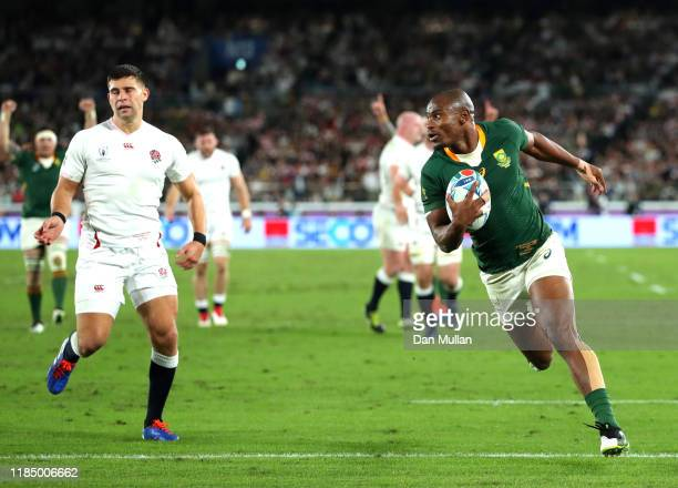 Makazole Mapimpi of South Africa breaks through to score his team's first try during the Rugby World Cup 2019 Final between England and South Africa...