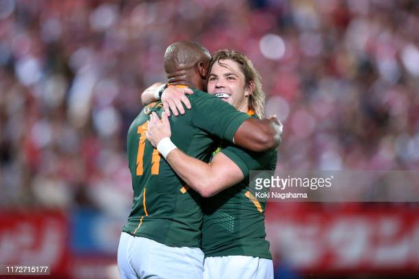 Makazole Mapimpi of South Africa celebrates scoring his side's fourth try with his team mate Faf de Klerk during the international match between...
