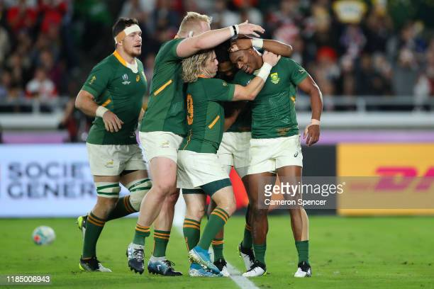 Makazole Mapimpi of South Africa celebrates with Lukhanyo Am Vincent Koch and Faf de Klerk after scoring his team's first try during the Rugby World...