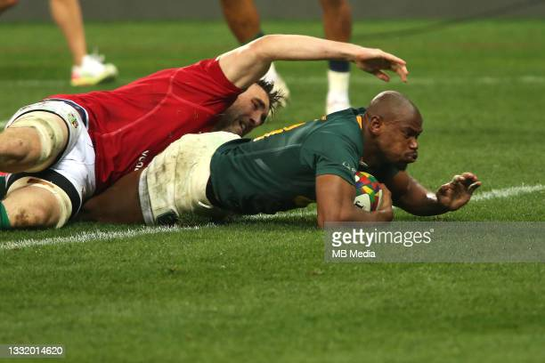 Makazole Mapimpi of South Africa dives over to score a try during the second test between South Africa and the British & Irish Lions at FNB Stadium...