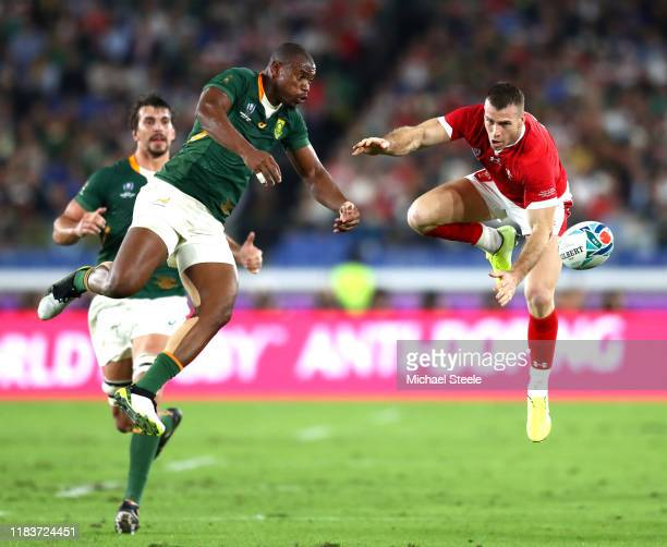 Makazole Mapimpi of South Africa goes for the high ball against Gareth Davies of Wales during the Rugby World Cup 2019 SemiFinal match between Wales...