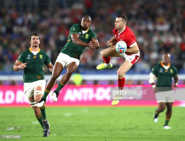 Makazole Mapimpi of South Africa goes for the high ball against Gareth Davies of Wales I during the Rugby World Cup 2019 SemiFinal match between...