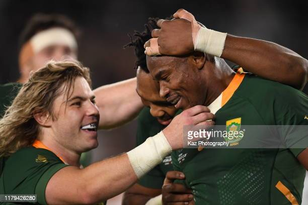 Makazole Mapimpi of South Africa is congratulated by teammate by Faf De Klerk after scoring the opening try during the Rugby World Cup 2019 Final...