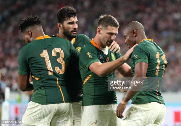 Makazole Mapimpi of South Africa is congratulated by teammates after scoring his team's third try during the Rugby World Cup 2019 Quarter Final match...
