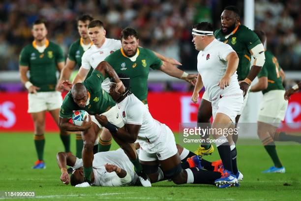 Makazole Mapimpi of South Africa is tackled by Kyle Sinckler and Maro Itoje of England during the Rugby World Cup 2019 Final between England and...