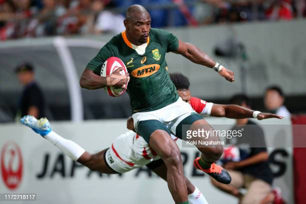 Makazole Mapimpi of South Africa runs past Kotaro Matsushima of Japan to score his side's fourth try during the international match between Japan and...
