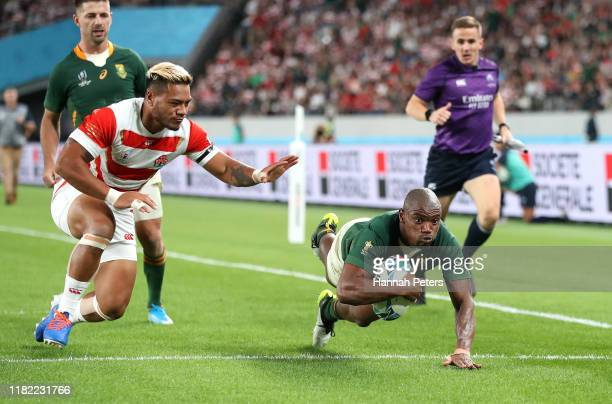 Makazole Mapimpi of South Africa scores his team's third try past Lomano Lemeki of Japan during the Rugby World Cup 2019 Quarter Final match between...