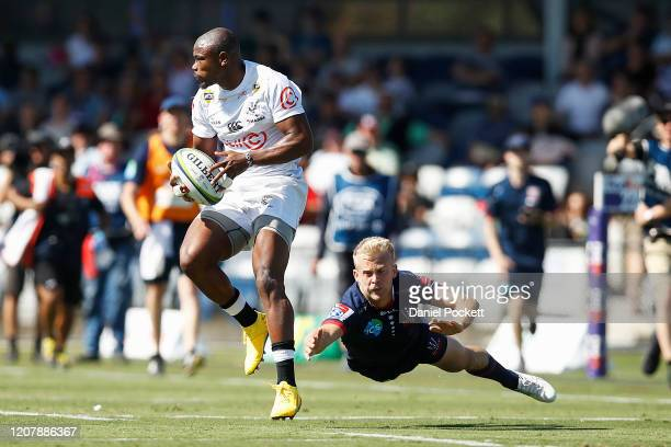 Makazole Mapimpi of the Sharks runs with the ball during the round four Super Rugby match between the Rebels and the Sharks at Mars Stadium on...