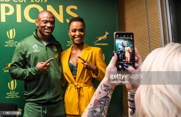 Makazole Mapimpi of the Springboks with Miss South Africa during the South African national rugby team arrival media conference at OR Tambo...