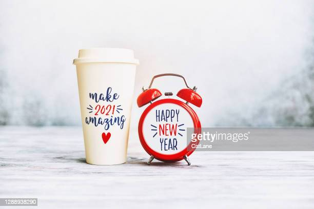 make 2021 amazing. happy new year background with clock and coffee cup - 2021 stock pictures, royalty-free photos & images