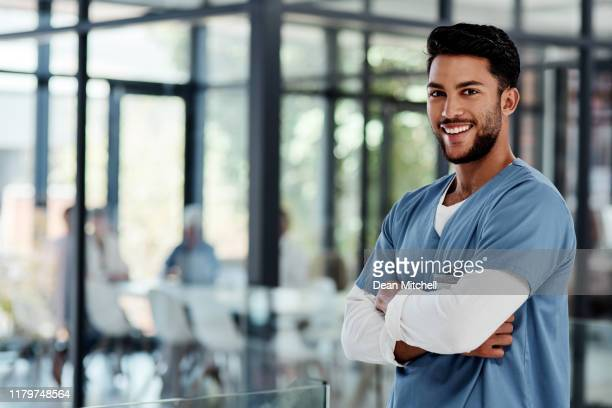 i make a difference each and every day - male nurse stock pictures, royalty-free photos & images
