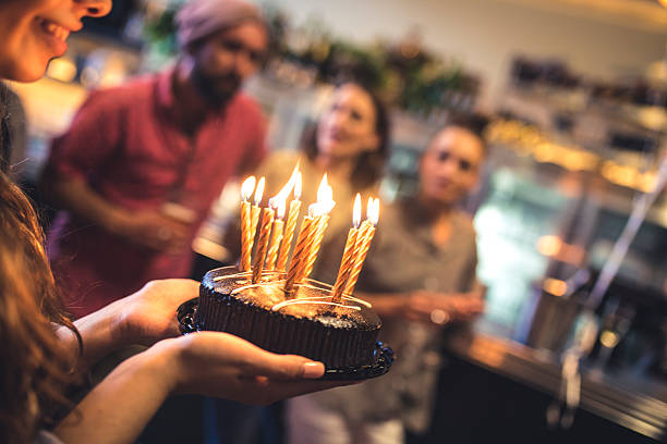 make a wish! - best friend birthday cake stock pictures, royalty-free photos & images