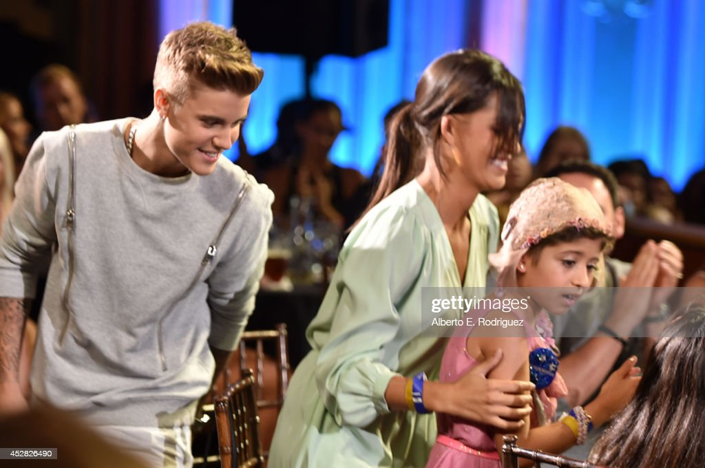 Make A Wish recipient Wish Child Grace (R) and honoree Justin Bieber speak onstage at the 2014 Young Hollywood Awards brought to you by Samsung Galaxy at The Wiltern on July 27, 2014 in Los Angeles, California. The Young Hollywood Awards will air on Monday, July 28 8/7c on The CW.