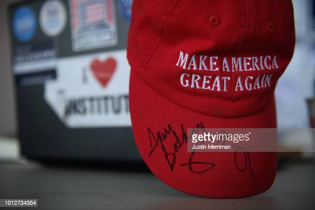 A 'Make America Great Again' hat signed by Vice President Mike Pence and Troy Balderson sits in Balderson's Westerville field office as voters take...