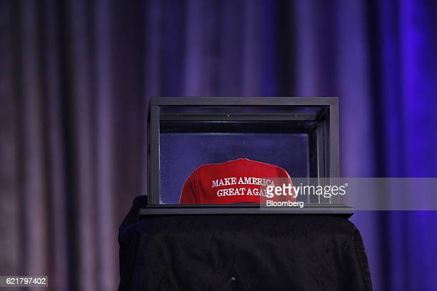 A 'Make America Great Again' hat sits in a box on a table ahead of an election night party for 2016 Republican Presidential Nominee Donald Trump at...