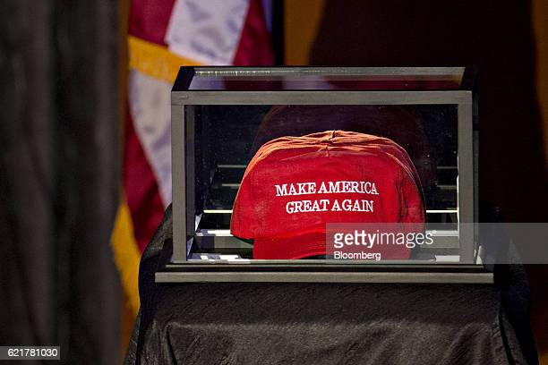 A 'Make America Great Again' hat sits in a case on the stage in the grand ballroom of the Hilton Midtown hotel ahead of Donald J Trump 2016...