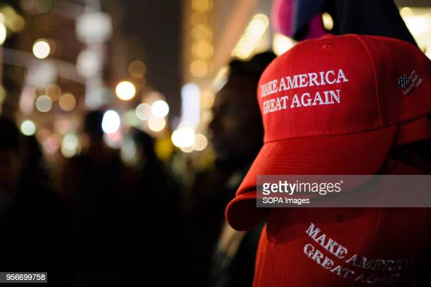 Make America Great Again red baseball caps signature headwear of the Donald Trump campaign and its supporters stand on sale on 6th Avenue in Midtown...