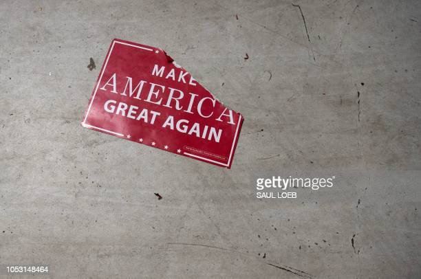 A Make America Great Again sign sits on the floor following a campaign rally with the US president at Central Wisconsin Airport in Mosinee Wisconsin...