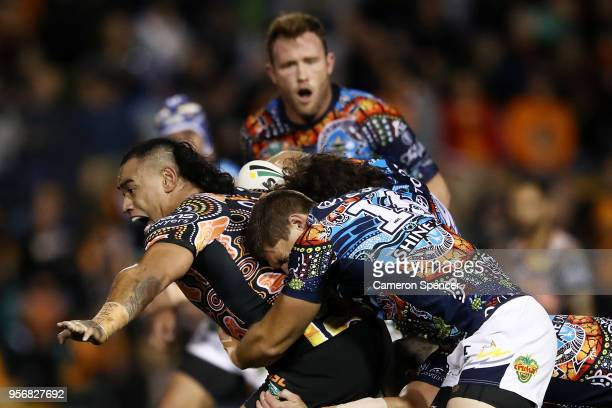 Make Fonua of the Tigers is tackled during the round 10 NRL match between the Wests Tigers and the North Queensland Cowboys at Leichhardt Oval on May...