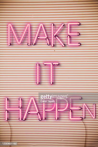 make it happen text in neon lights - initiative stock pictures, royalty-free photos & images