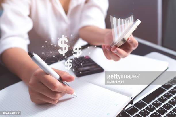 make money on internet. woman working on a laptop - marketing icons stock photos and pictures