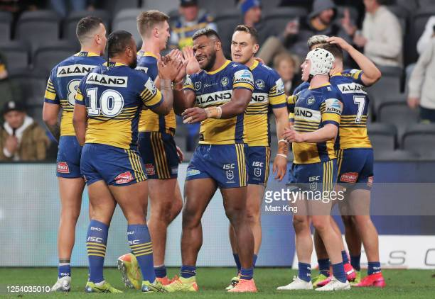 Make Sivo of the Eels celebrates with team mates after scoring his third try during the round eight NRL match between the Parramatta Eels and the...