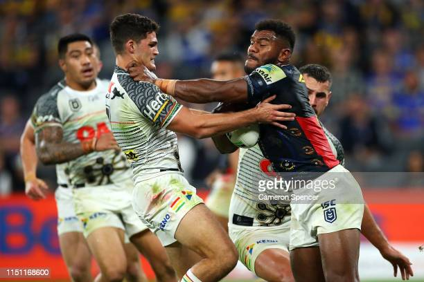 Make Sivo of the Eels is tackled during the round 11 NRL match between the Parramatta Eels and the Penrith Panthers at Bankwest Stadium on May 23,...