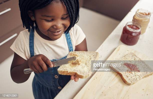 i make sure my bread is buttered on both sides - peanut butter and jelly sandwich stock pictures, royalty-free photos & images
