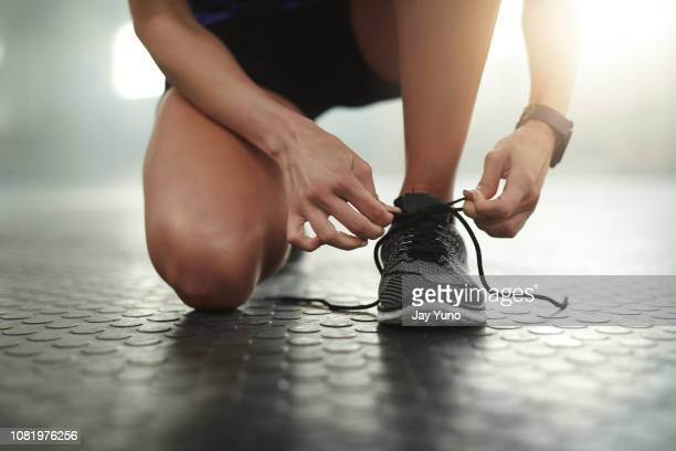 make sure you exercise in comfy shoes - lace fastener stock pictures, royalty-free photos & images