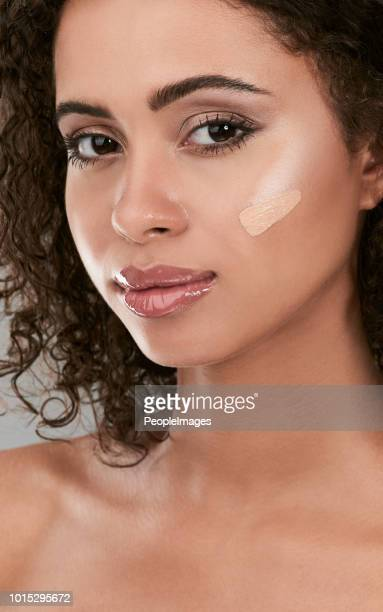 make sure your foundation matches your skin for even coverage - concealer stock pictures, royalty-free photos & images