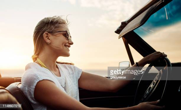 make the most of summer before it's over - convertible stock pictures, royalty-free photos & images