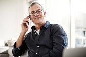 portrait mature man talking cellphone at